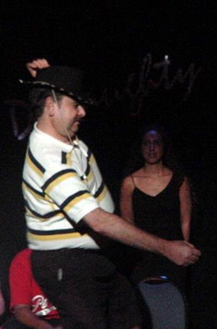 A hypnotised show goer doing a dance